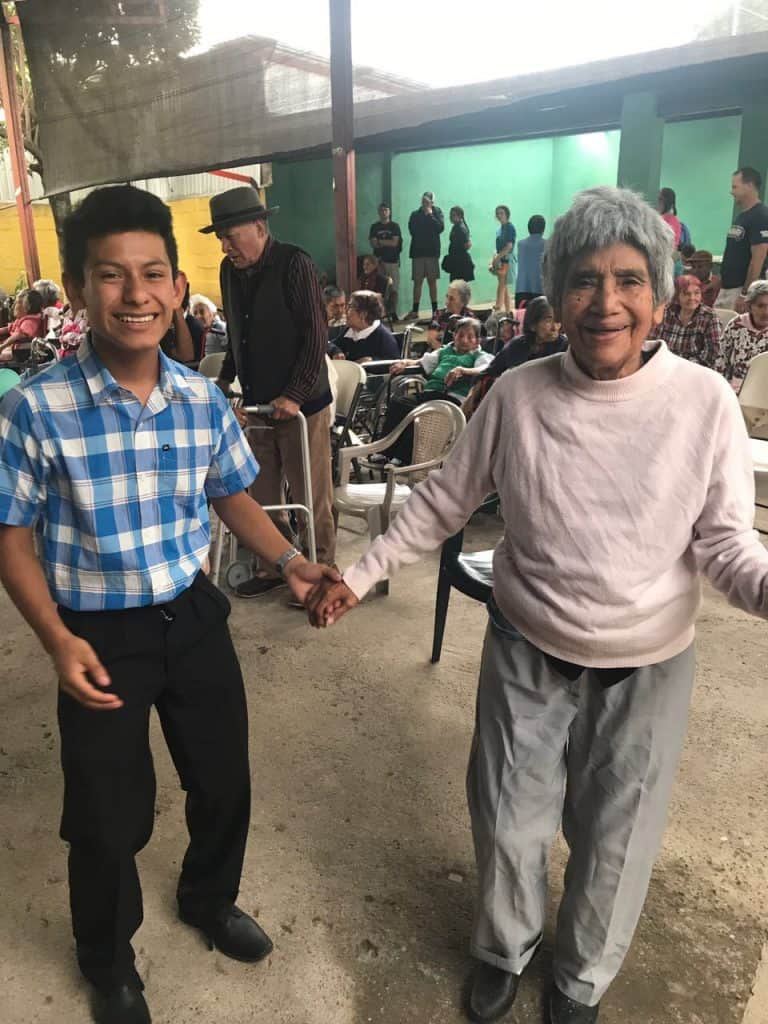 A student from Escuela Integrada dances with a resident at Casa Maria. Photo by Hannah Nadeau.