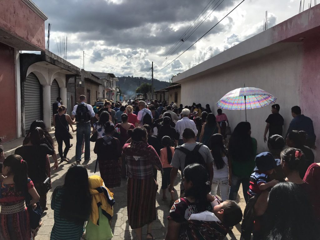 Escuela Integrada volunteers walk with friends and family from the funeral to the burial site on Saturday, Aug. 5, 2017. Photo: Mike Neubauer.
