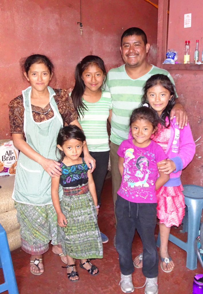 Maria and Jose stand with their four girls in the space they rented on July 4, 2017. Photo: Juliana Anderson.