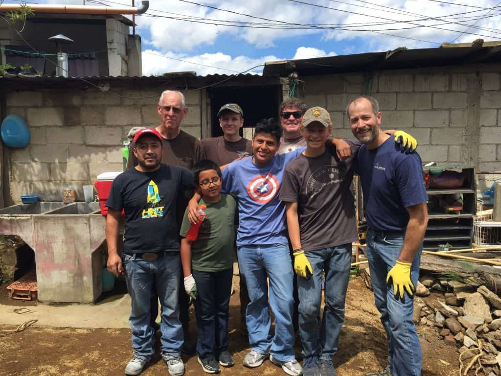 Local contractor Carlos, front left, and interpreter, Victorino, front center, stand with volunteers from Northview Bible Church next to the project site.
