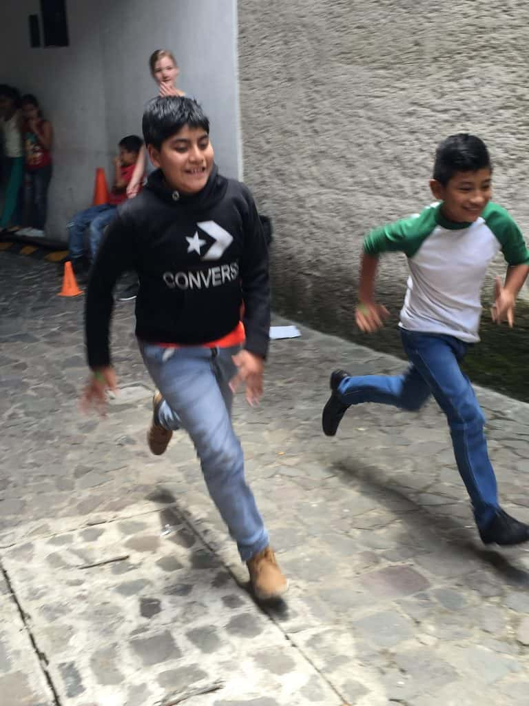 Two kids race at Escuela Integrada during a muscle workshop taught by volunteers from Northview Bible Church.