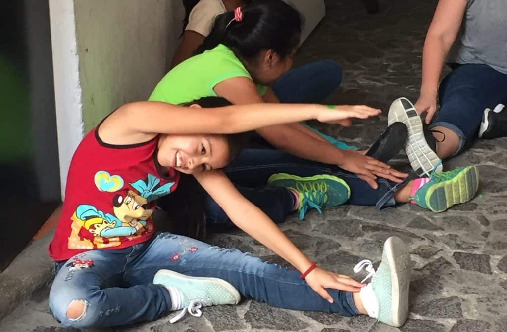 A student at Escuela Integrada practices a stretch she learned during a workshop with volunteers from Northview Bible Church.