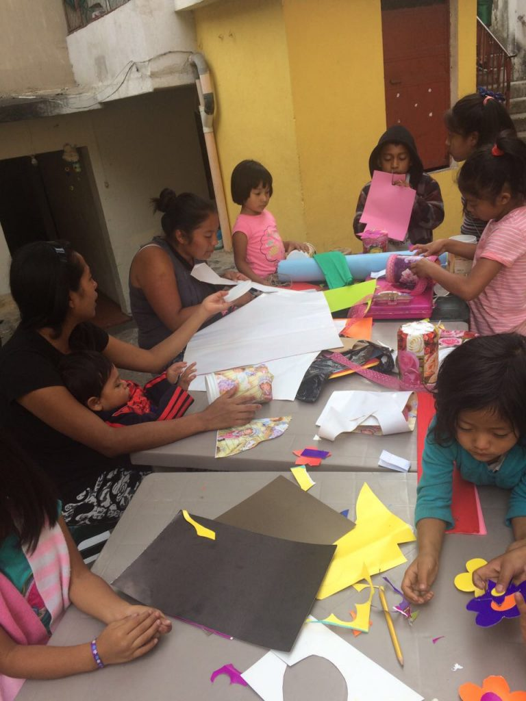 Morales leads a craft project for the girls in Proyecto Capaz.