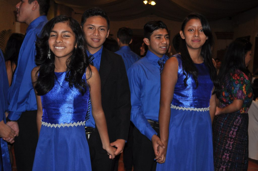 The 9th grade students performed a ballroom dance during the graduation ceremony.