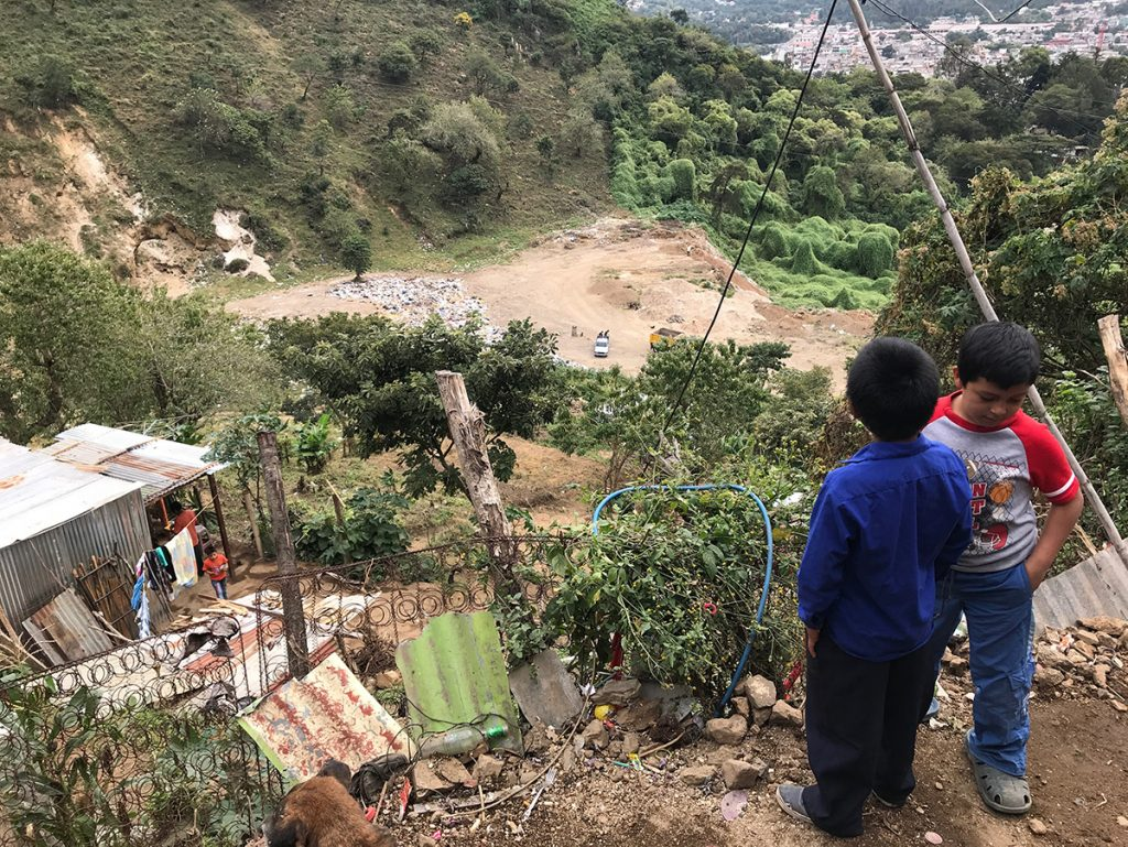 Kids from Escuela Integrada look down from one of their homes toward the local dump in Jocotenango on Nov. 7, 2017.