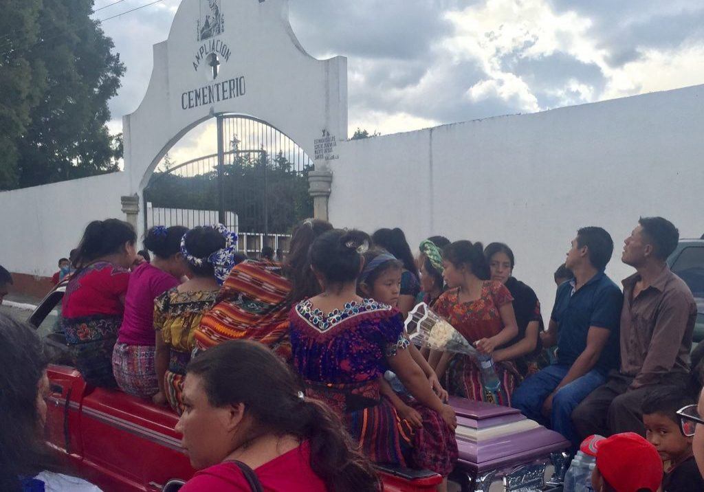 Maria Fernanda, 11, Evelyn, 9, Norma, 8, and Anita, 4, ride in the back of a truck with family members and the casket of their mother. Maria, 37, died Saturday, Aug. 5, 2017. Photo: Autumn Jones.