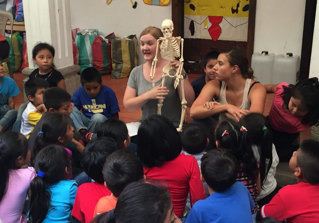 Krystal Roach teaches a lesson about bones and muscles at Escuela Integrada on Tuesday, August 1, 2017.