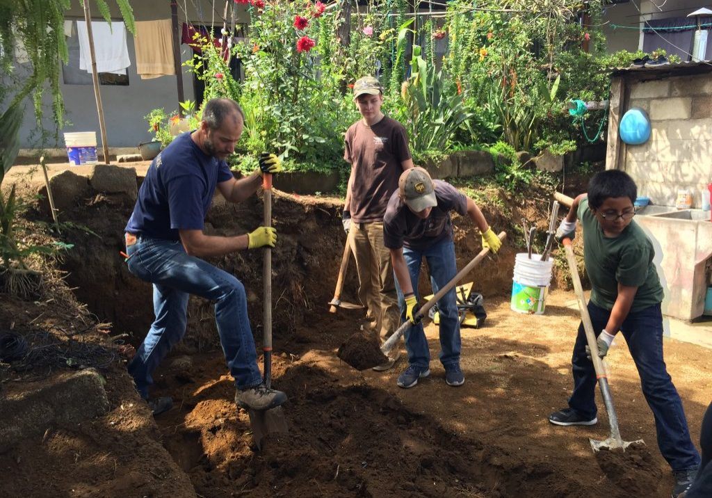 Volunteers from Northview Bible Church in Spokane, Washington, dig the foundation of a bathroom for an Escuela Integrada family on Monday, July 31, 2017.