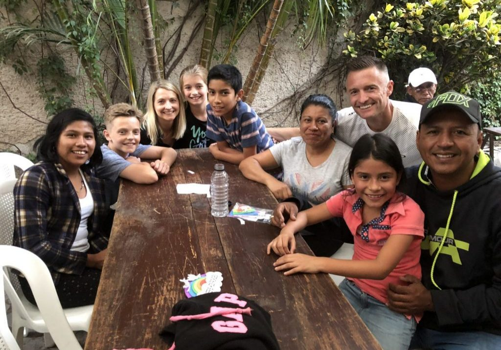 Mike, Jaime, Reese and Landon Olson spent time with the kids they sponsor and their family at an Escuela Integrada family night on June 12, 2018.
