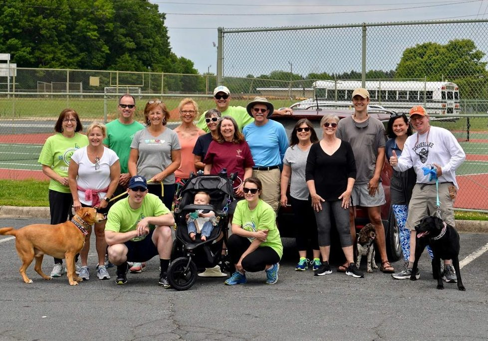 Runners and walkers in Salisbury, North Carolina, showed their support for Escuela Integrada on May 16, 2021.